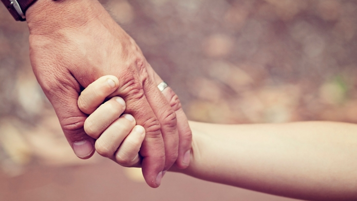 Father and daughters hands