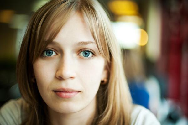 A sad young woman looking at camera
