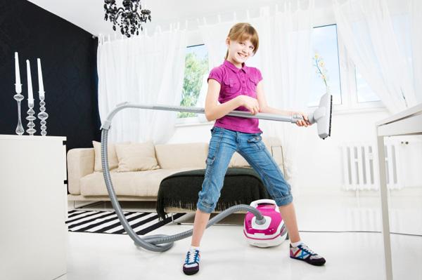 Teen Girl with Vacuum