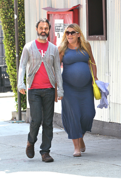 Pregnant Busy Philipps and husband