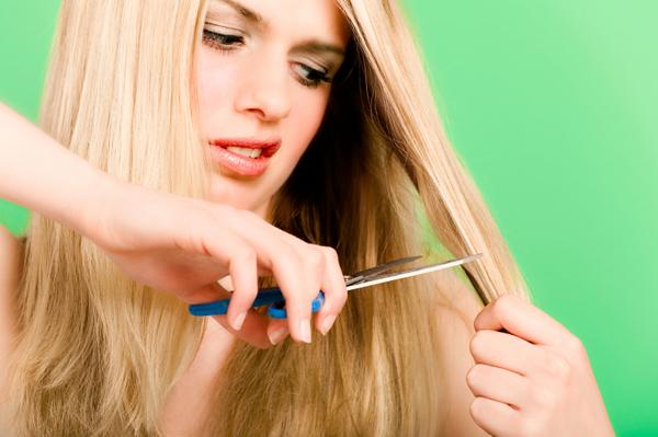 pregnant woman cutting hair