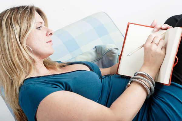 Pregnant Woman Writing in Diary