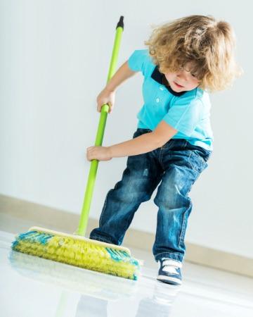 Preschooler helping with chores