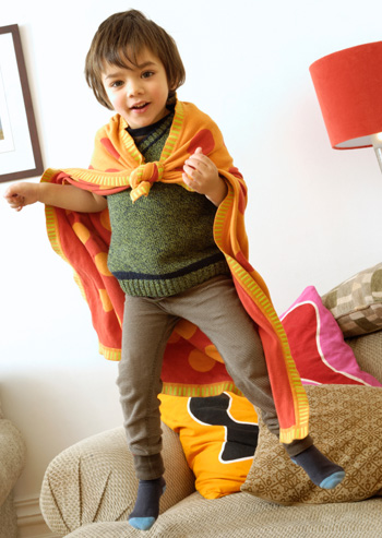 Preschooler jumping on couch