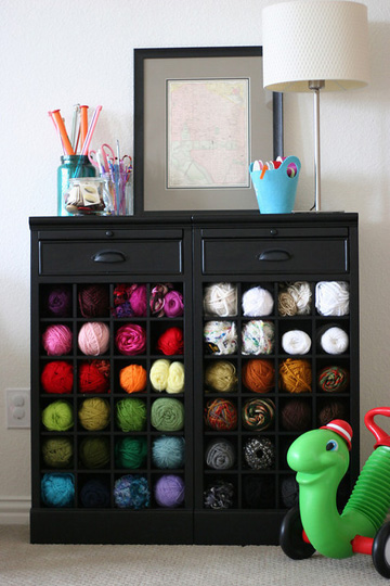 Using a wine rack as yarn storage puts them out on display and helps you stay organized.
