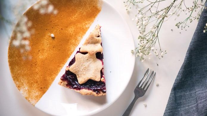 Slice of cherry pie on decorated