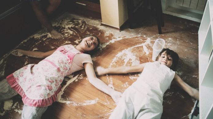 Two children lying on floor in