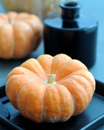 Pumpkin on black tray