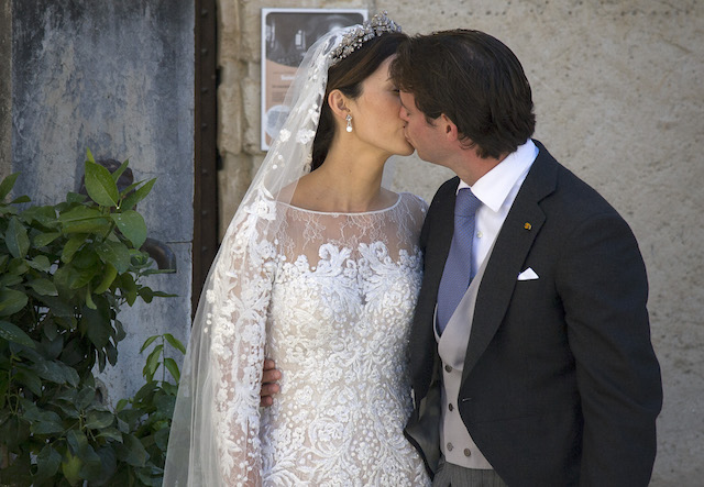 Princess Claire of Luxembourg & Prince Felix of Luxembourg kiss on their wedding day