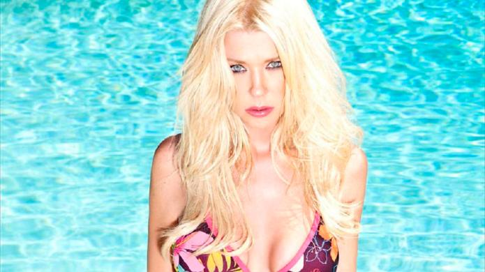Tara Reid does the impossible and
