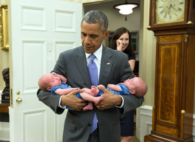 Barack Obama holding twins