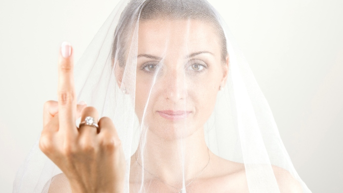 Young bride showing middle finger while