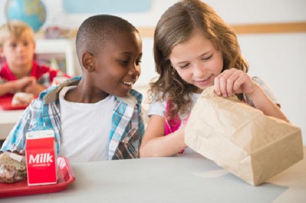 School children (8-9) at lunch break