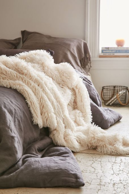 The Biggest Fall Decor Trends of 2018: Sheepskins and fur bring warmth to any room.
