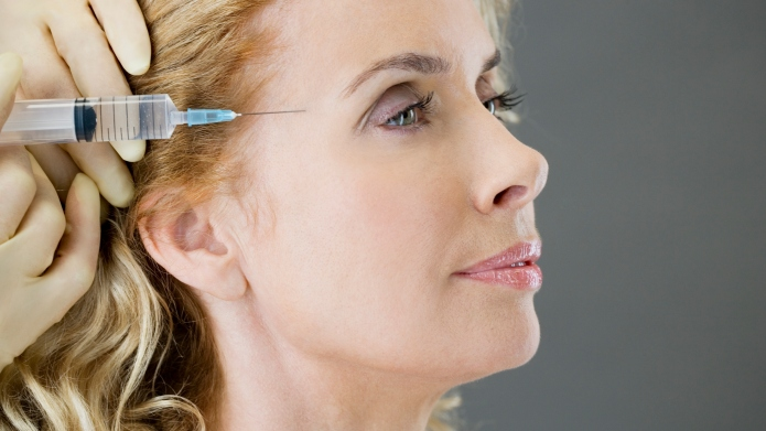 Middle-aged woman having a botox injection