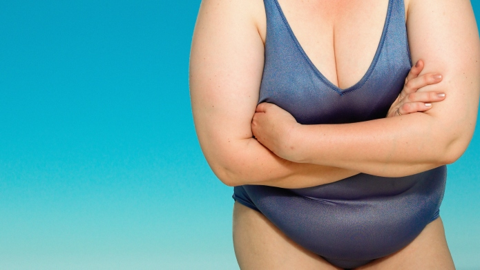 Overweight woman in swim suit