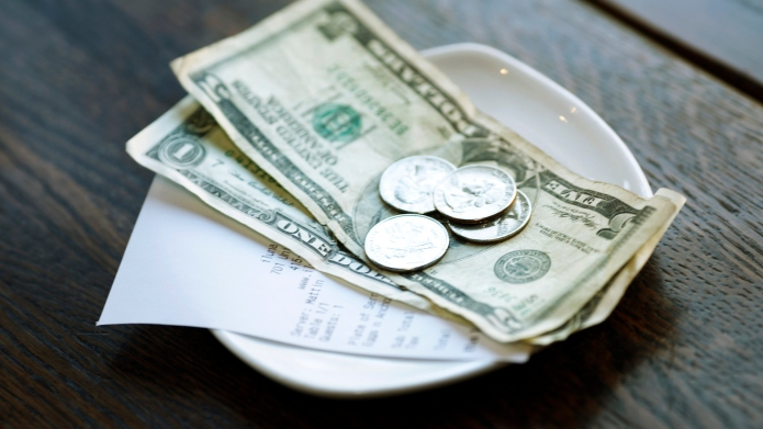 Restaurants that abolish tipping are making