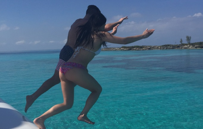 Dorothy Wang jumping into the Bahamas ocean.