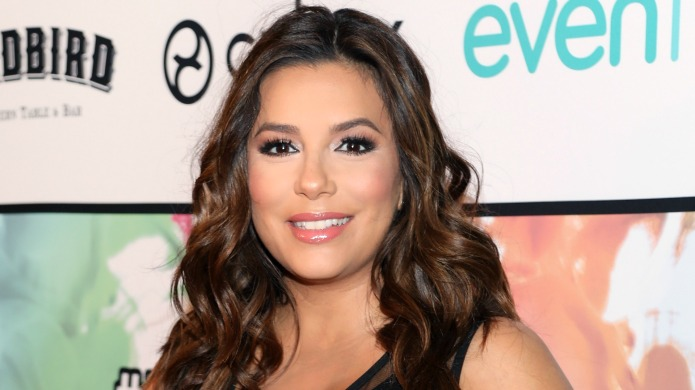 Eva Longoria smiles at an event
