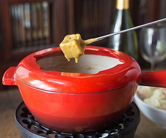 Guinness cheddar fondue in red pot