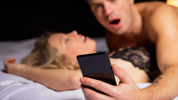 Surprised man looking at his phone