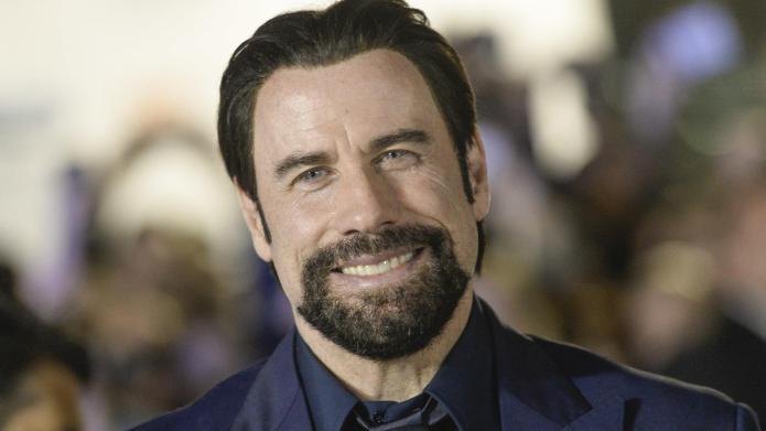 John Travolta finally opens up (kinda)
