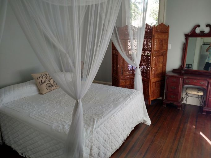 Fixer Upper Houses for Rent: The Mailander House has a super serene master bedroom