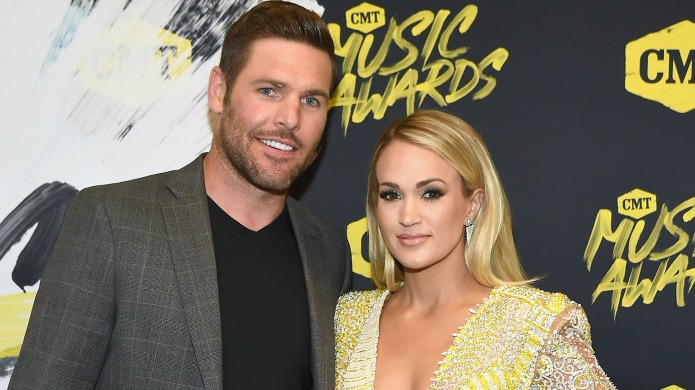 Mike Fisher and Carrie Underwood attend