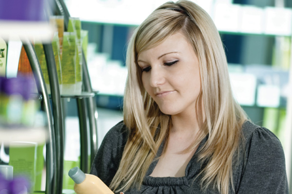 woman reading label in aisle