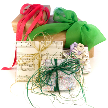presents wrapped with recycled paper and bows