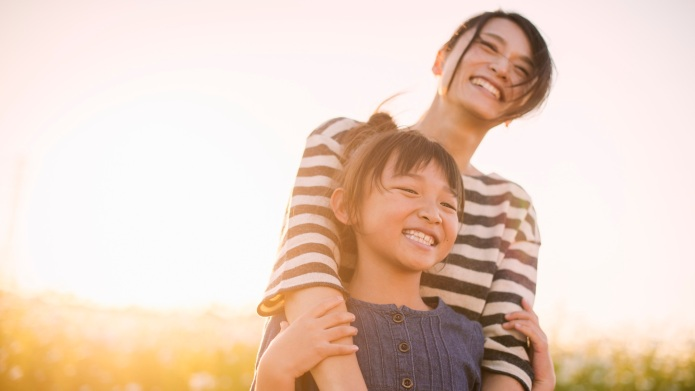 Sunset time,Mother anddaughterwith Cosmos flowers,Girl of