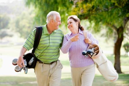 Retired couple golfing