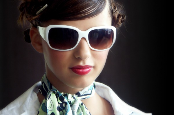 Woman with retro sunglasses and scarf