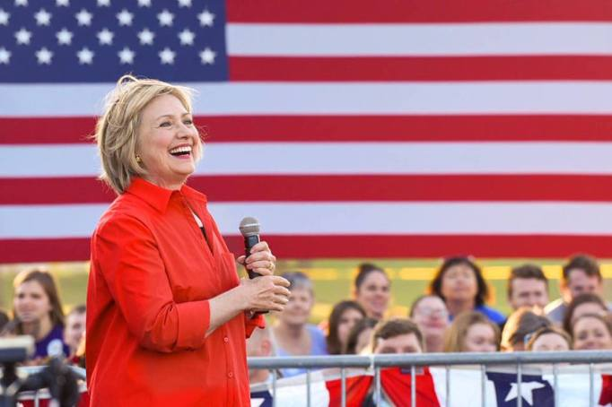 Hillary Clinton speaking in front of the American flag