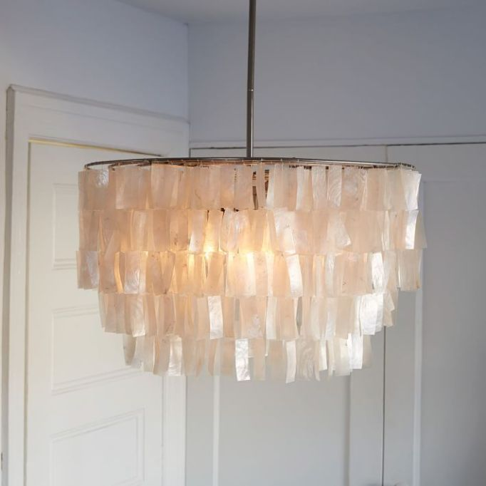 Modern Victorian Decor: An updated chandelier adds modern elegance to your home