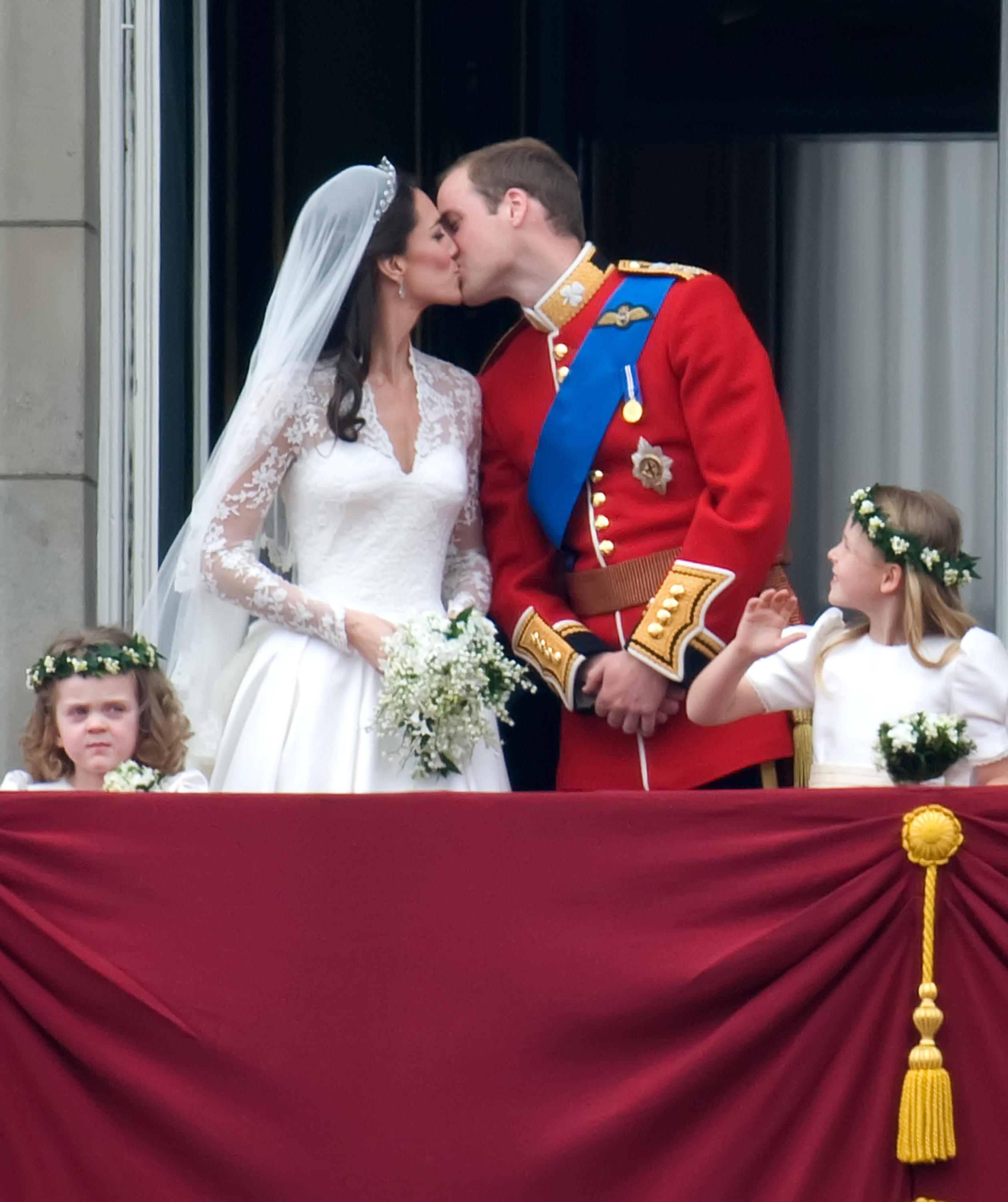 Kate Middleton in her wedding dress, kissing Prince William