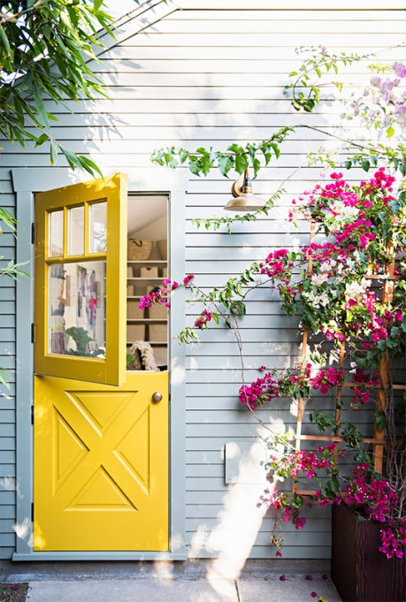 Yellow Dutch door with light blue wall