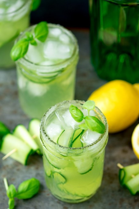 Summer cocktail recipe: muddled cucumber and basil leaves add a refreshing twist on a classic gin and tonic.