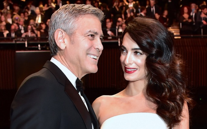 George and Amal Clooney embrace at the 42nd Cesar Awards in Paris, France, in early 2017