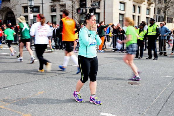 Runners reacting to the Boston Marathon bombing