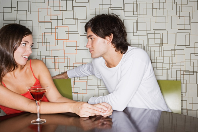 Man moving closer to woman in