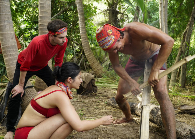 Simone Nguyen, Ryan Ulrich and Devon Pinto work at camp on Survivor: Heroes Vs. Healers Vs. Hustlers