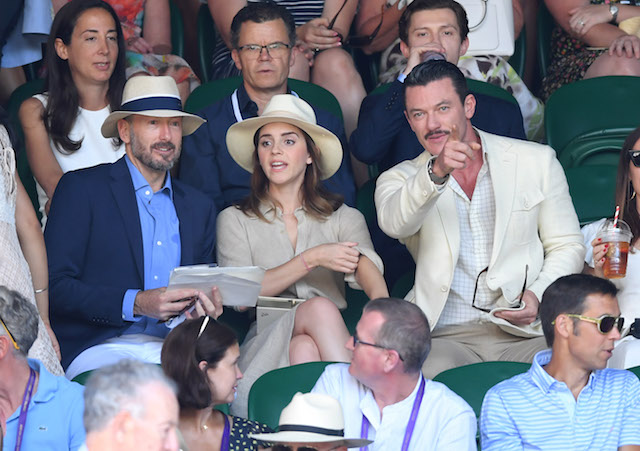John Vosler, Emma Watson and Luke Evans attend the men's single final on day 13 of the Wimbledon Tennis Championships