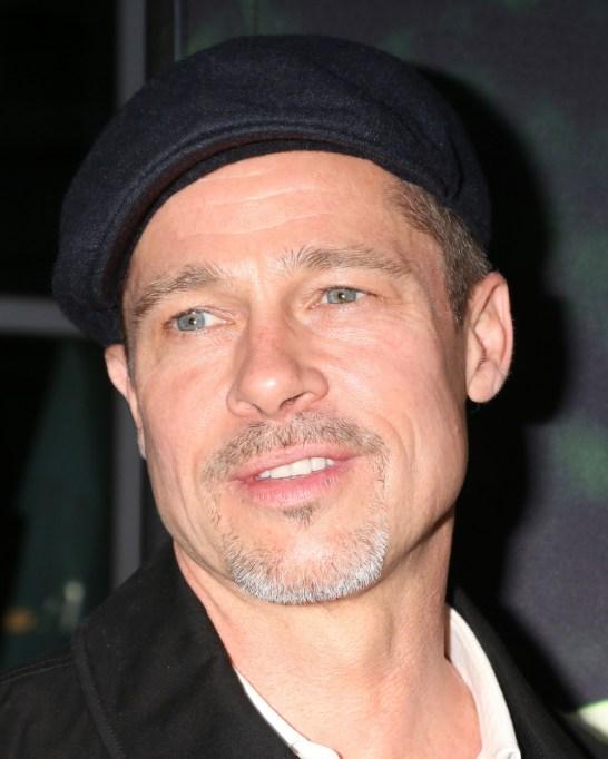 Brad Pitt in a black cap