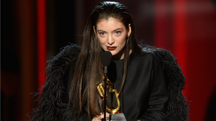 Lorde dresses like a bird, swoops