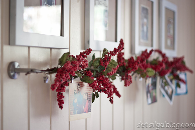 holiday card display with cranberry garland