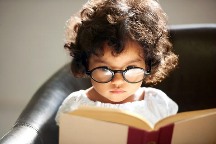 A cute little girl wearing glasses