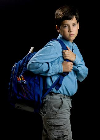 Sad boy with backpack