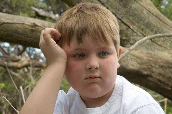Sad Child at Camp