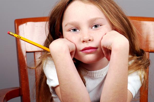 Sad girl doing homework